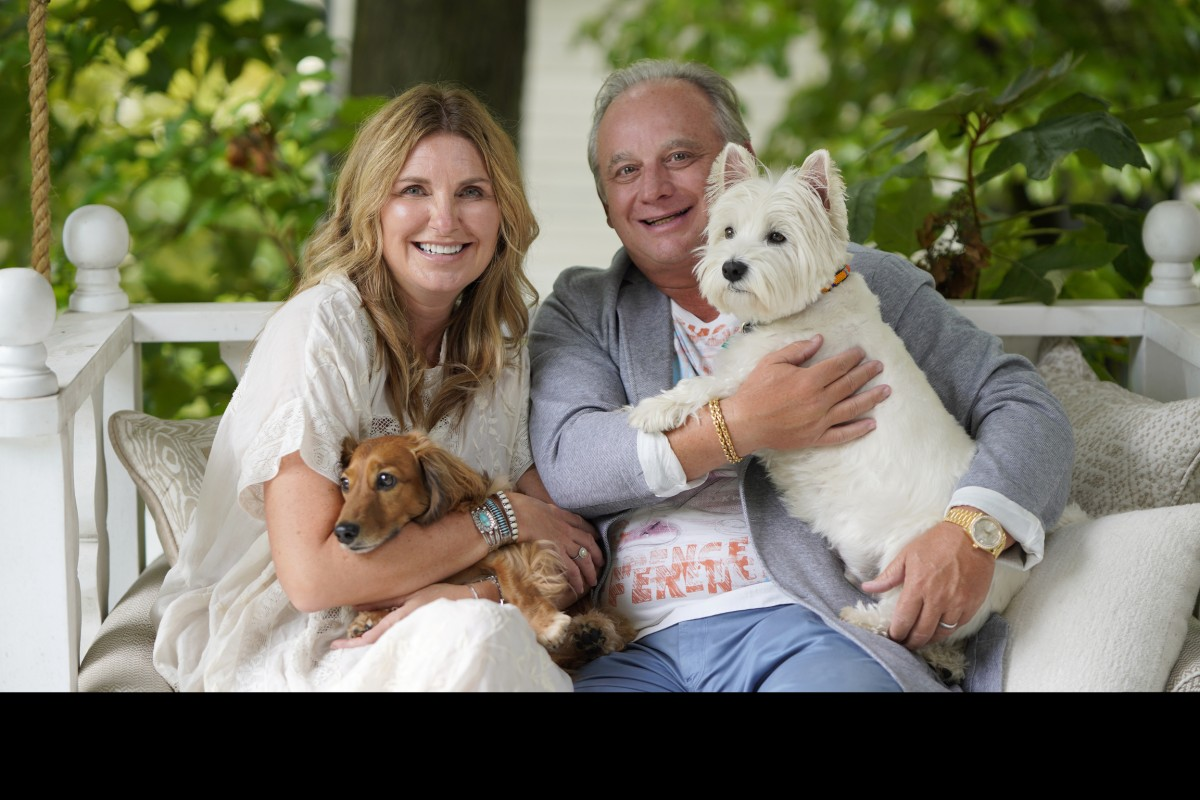 Chuck McDowell and His Wife with Dogs.jpg